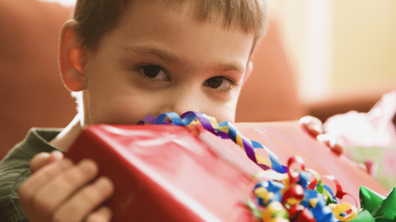 Young boy with gift