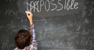 Boy doing math chalkboard