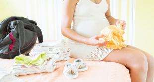 Pregnant woman packing hospital bags