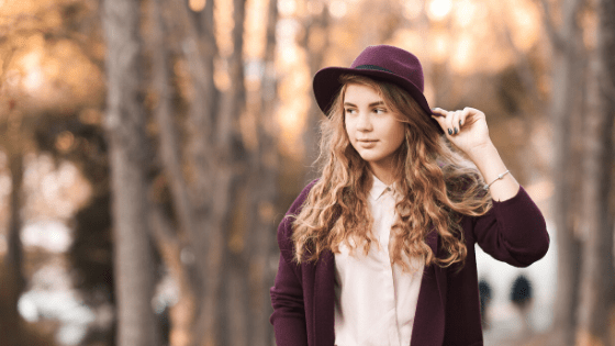 Teen girl wearing hat