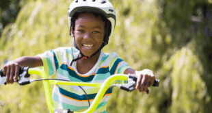 Happy child cycling