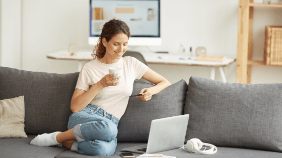 Woman on couch online shopping