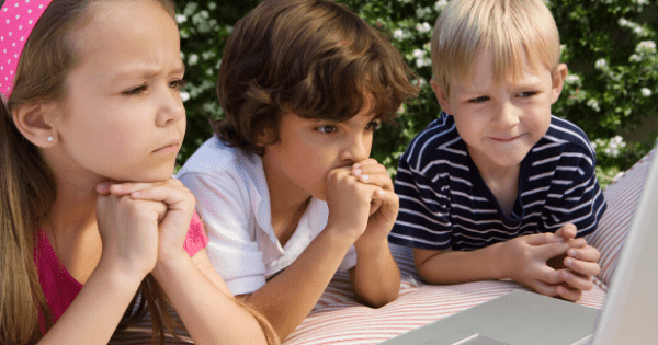 3 Kids Learning At Laptop