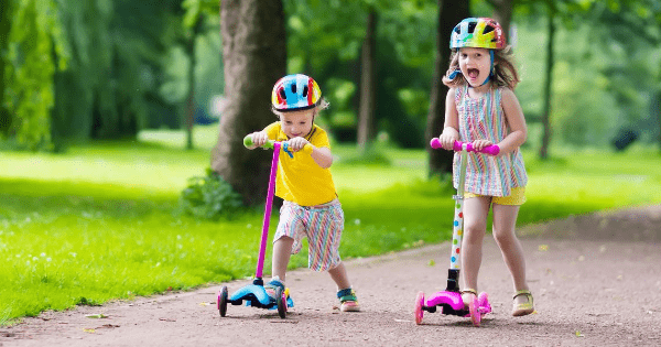 Siblings Riding Scooters