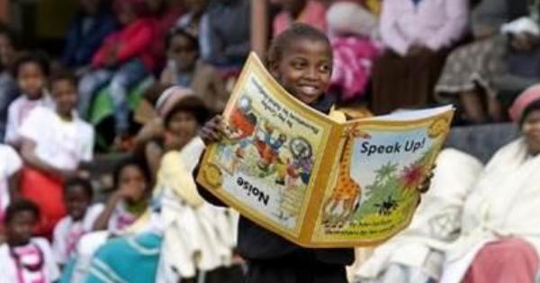 Child holding big book