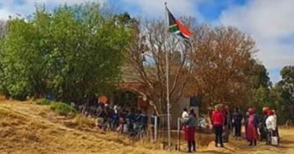 School kids hoisting SA flag