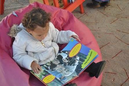 Child reading on beanbag