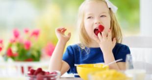 Girl eating berries