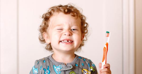 Toddler Holding Toothbrush