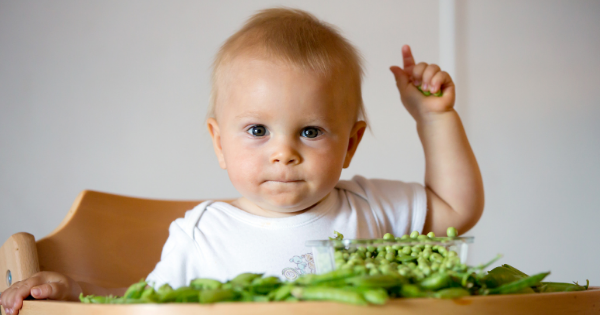 Child Eating Greens