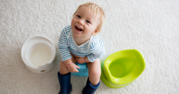 Happy boy on potty
