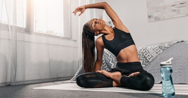 Woman with braided hair doing yoga