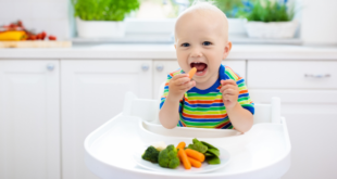Young kid eating veggies