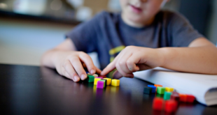 Child Doing School Activities At Home