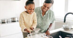 Mother daughter baking together