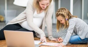 Mompreneur doing homework with child