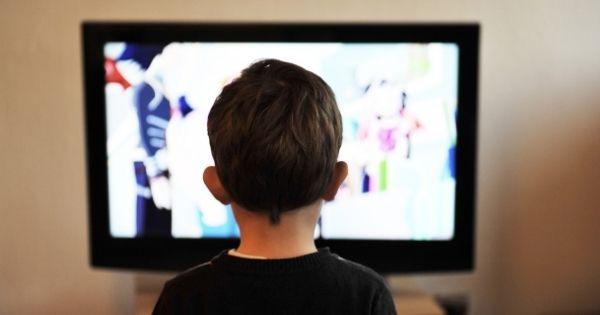 Boy watching Tv show
