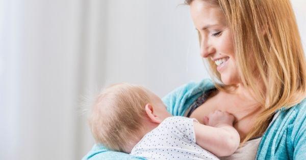 Mom breastfeeding on the go