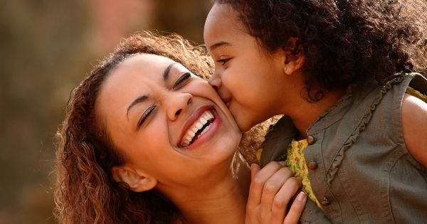 Mother child kissing