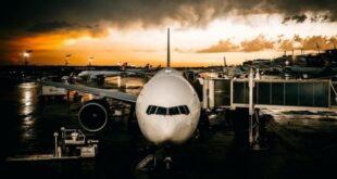 Airplane at terminal sunset
