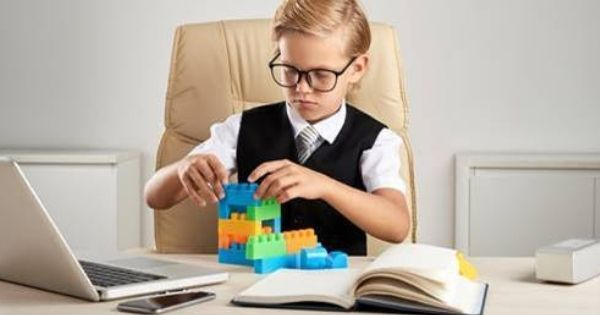 Child concentrating on project