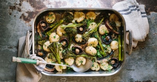 Mushroom, broccolini & cracked baby potato tray bake with garlic butter