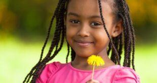 Pretty black girl holding flower