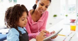 Mother daughter on tablet together