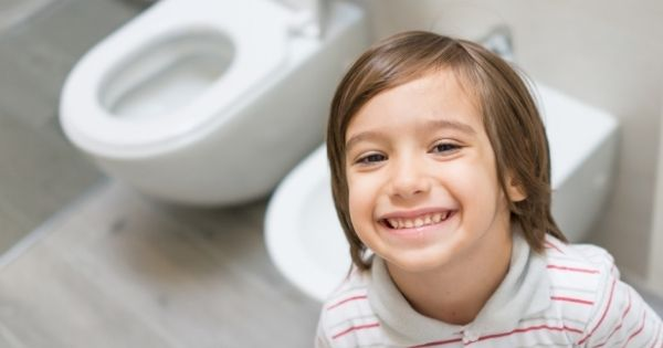Smiling child in bathroom