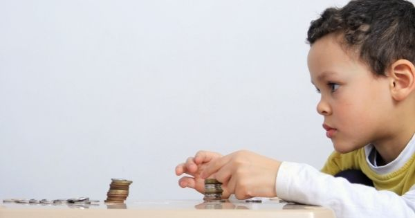 Child counting coins